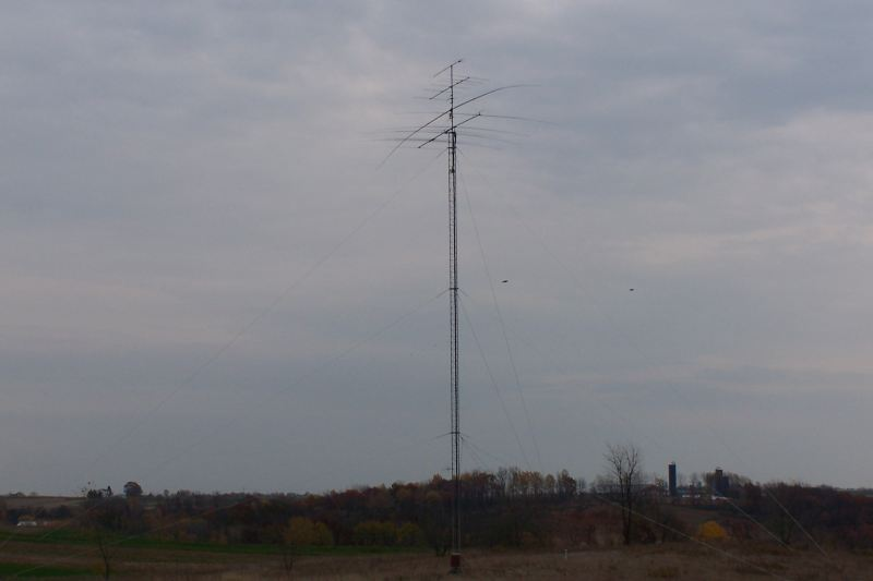 Tower and antennas,with feedline properly dressed down the side of the tower. 160m vee not installed yet.
