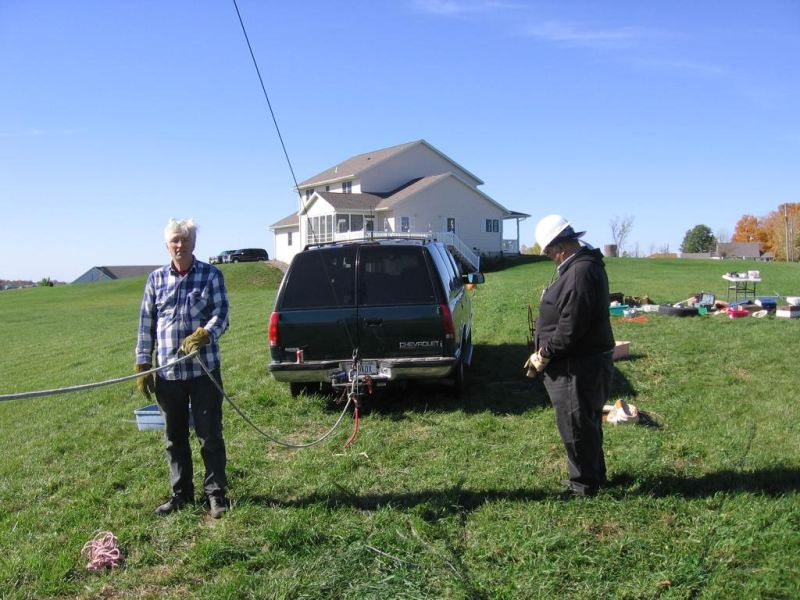 (L-R) Bill KE9XQ and Mark N9UNW assist as the 6m beam is pulled up the tram line. (pic courtesy WA9HCZ)