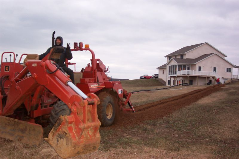 My friend Gary from the phone company doing the trenching thing.