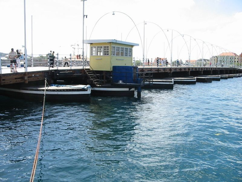Queen Emma Pontoon Bridge – a floating pedestrian bridge that swings open for passing ships and boats.