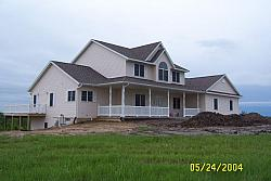 Picture of the front of our new house.  The shack is in the basement, which is visible on the lower left corner of this picture,