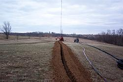 Trencher almost done with 300 foot long trench, which will contain 8 runs of hardline, 3 runs of three conductor direct bury ele