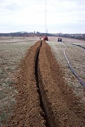 Trench was about 3 feet deep.  Trenching was done on December 16th, 2004, perhaps a day or two before the ground froze.