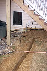 The house end of the trench.  Radio room is behind window to the left.  Two 4 inch PVC pipes going into the house can be seen to