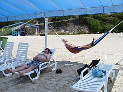 Mike and Chad taking a snooze, at the Sunset Waters Beach Resort.
