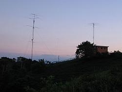 NP4Z QTH, looking South. Tower on right is 85ft with Bencher Skyhawk.  Tower on left is 130ft with Force 12 antennas for 40, 15