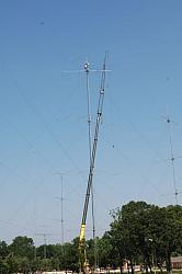A nice picture of John W2GD and Don K4ZA installing the tall 15  7 ele OWA atop the 20 stack (@199')....
